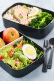 Lunch boxes with food ready to go for work or school. Meal preparation or dieting concept royalty free stock images