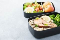 Lunch boxes with food ready to go for work or school. Meal preparation or dieting concept. Copy space royalty free stock photos