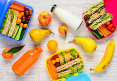Lunch Boxes with Fruits and Drinks Stock Image