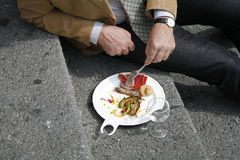 Lunch break. Italian business man eating his lunch outdoors in his break Royalty Free Stock Photo