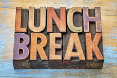 Lunch break banner in letterpress wood type. Lunch break banner - word abstract in vintage letterpress wood type printing blocks against grunge painted wood Royalty Free Stock Images