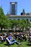 Lunch Break in Bryant Park. New Yorkers spending their lunch break in Bryant Park Royalty Free Stock Images