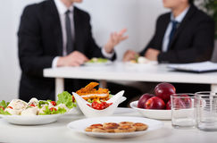 Lunch break. Close-up of a food and men during lunch break Royalty Free Stock Photo
