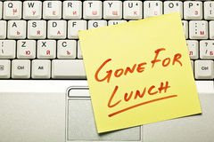 Lunch break concept. Yellow sticky note on a laptop keyboard with 'Gone for Lunch' on it Stock Images