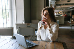Lunch break during work. Thoughtful business lady royalty free stock image