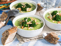 Lunch with broccoli soup. Broccoli soup in bowls for lunch with whole grain bread stock photography