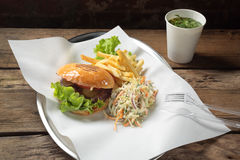 Lunch with a burger, fries, salad Royalty Free Stock Photography