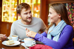 Lunch in cafe. Young affectionate couple spending time in cafe royalty free stock photo