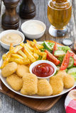 lunch with chicken nuggets, french fries, salad and beer Royalty Free Stock Photography
