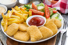 Lunch with chicken nuggets, french fries, salad Stock Images