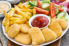 Lunch with chicken nuggets, french fries, salad, closeup Royalty Free Stock Photography