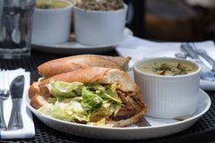 Lunch combo included sandwich and soup. Outside. Business lunch for two. Lunch combo included crispy fresh sandwich with lettuce, sauce and meat and soup on the royalty free stock images