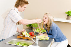 Lunch couple cook salad man feeding woman Stock Photo
