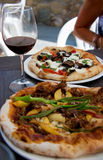 Lunch Date. Enjoy brick oven baked pizza on the patio Royalty Free Stock Photography