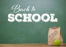 Lunch on Desk foreground with blackboard graphics of Back to school Royalty Free Stock Images