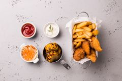 Lunch or dinner - chicken strips, french fries, corn and dips. Lunch or dinner - fried chicken strips, french fries, roasted corn and dips. Food captured from royalty free stock photos