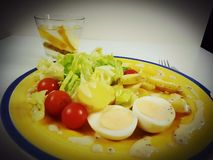 Lunch dinner food drink water lemon. Eggs salat tomato sausage eat table plate Stock Photography