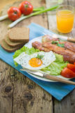 Lunch,Dinner,Supper. Breakfast or dinner or lunch with eggs bacon and a few tomatoes Stock Photography