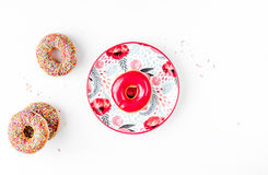 Lunch with donuts on plate white table background top view mock up. Tasty lunch with colorful donuts on plate on white table background top view mock up Royalty Free Stock Image