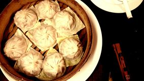 Taiwanese Dumpling in sepia tone in a bamboo basket with dark background  Royalty Free Stock Image