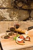 Lunch in France. With wine, bread and cheese dish on a board Stock Photo