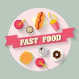 Lunch with french fries, hot dog, burger, cupcake, donut, coffee and soda. Fast food. Flat lay design. Stock Photos