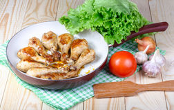 Lunch fried chicken legs and vegetables on wooden table Stock Photos