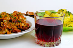 Lunch fried fish, boiled potatoes and red wine. Royalty Free Stock Images