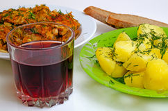 Lunch fried fish, boiled potatoes and red wine. Stock Image