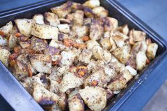 Lunch fried potato with carrot and seasonings. stock image