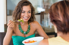 Lunch Between Friends. Happy Woman With Salad In Front Of Female Friend At Cafeteria Royalty Free Stock Photography