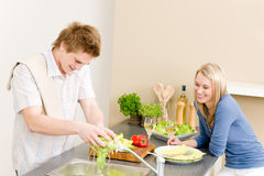 Lunch happy couple cook salad in kitchen Stock Images