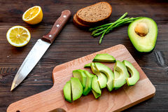 Lunch with healthy avocado sandwich on wooden kitchen table background Stock Image