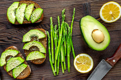 Lunch with healthy avocado sandwich on wooden kitchen table background top view Royalty Free Stock Images