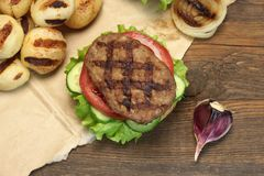 Lunch With Homemade BBQ Grilled Hamburgers On The Picnic Table Royalty Free Stock Photo