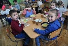 Lunch in kindergarten stock images