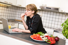 Lunch in Kitchen with Laptop Stock Image
