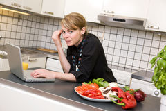 Lunch in Kitchen with Laptop Royalty Free Stock Images