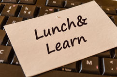 Lunch and learn text note. Computer Keyboard with white note and text lunch and learn Stock Photo