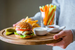 Lunch menu. With small burger, french fries and vegetable sticks stock photography
