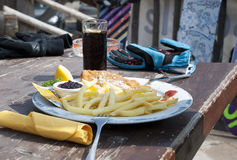 Lunch of mountain skiers  in cafe on the mountain in Livigno. Royalty Free Stock Images