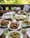 Lunch the outdoor café with plenty food and lemonade on a table Royalty Free Stock Photography