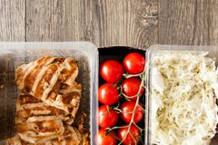 Lunch packed in different boxes. Close up of lunch packed in different boxes. Fresh and healthy eating on wooden background Stock Photography