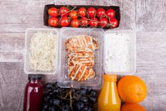 Lunch packed in different boxes. Fresh and healthy eating on wooden background Stock Images
