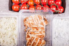 Lunch packed in different boxes. Fresh and healthy lifestyle. Wooden background Stock Photo