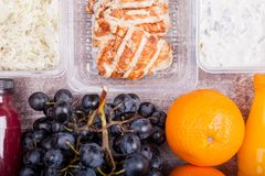 Lunch packed in different boxes. Fresh and healthy lifestyle. Wooden background Stock Photos