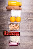 Lunch packed in different boxes. Fresh and healthy lifestyle. Wooden background Royalty Free Stock Photo