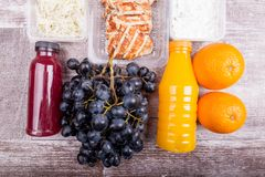 Lunch packed in different boxes. Fresh and healthy eating on wooden background Stock Image
