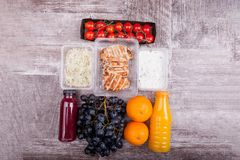 Lunch packed in different boxes. Fresh and healthy lifestyle. Wooden background Royalty Free Stock Photography