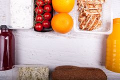 Lunch packed in different boxes. Over top view of lunch packed in different boxes. Fresh and healthy eating on wooden background Stock Photos
